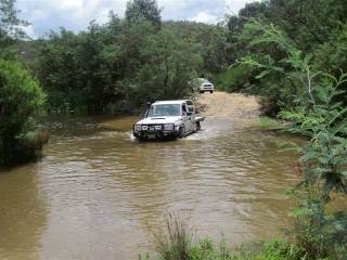 Land Cruiser ute in the river on a 4wd training course