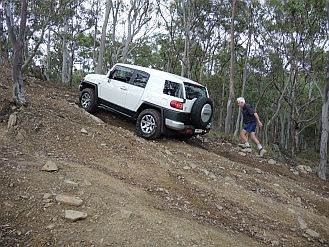 australian 4x4 driver training course cruiser on a hill