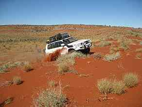 4wd crossing a dune on Australian 4x4 tag Along Tours 4wd Never Never Hay River 4wd tag along tour