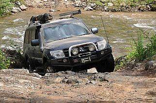 Pajeri exits Crooked River on an Australian 4x4 Tag Along Tours 4wd tag along trip