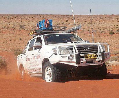 Australian 4x4 Tag Along Tours Hilux climbing Big Red sand dune