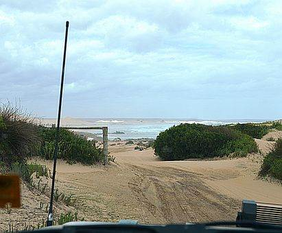 Driving onto Sandy cape Beach, Tasmania on Australian 4x4 Tag Along Tour