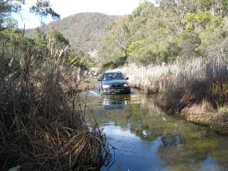 BMW X5 driving in river