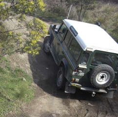 Land Rover Defender doing a steep climb