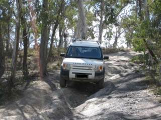 Land Rover negotiating a rut on a 4wd drive course
